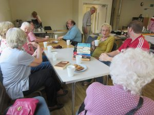 Group of visitors chatting over coffeee at the Swifts in Fulbourn
