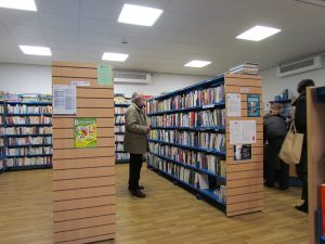 Visitor browsing book shelves at the library in Fulbourn